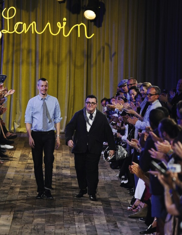 Israeli-American designer Alber Elbaz and Dutch designer Lucas Ossendrijver appear after the show for fashion house Lanvin in Paris
