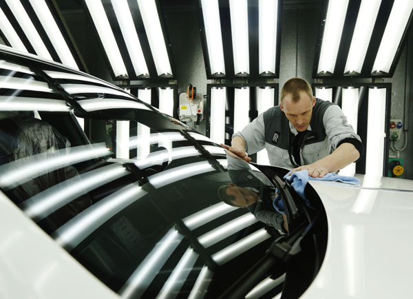 Employee Darren Lowarson give a Rolls Royce Ghost its final finish polish at the Rolls Royce Motor Cars factory at Goodwood near Chichester