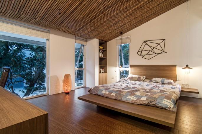 54f90646e58ece86bb000189_epv-house-ahl-architects-associates_epv_zbedroom1_view1