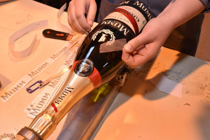 Before beginning its journey to the celebratory podium in Monte Carlo, the final preparations are made to the iconic Jeroboam of Cordon Rouge that will be awarded to the winner of the 2015 Monaco Grand Prix.